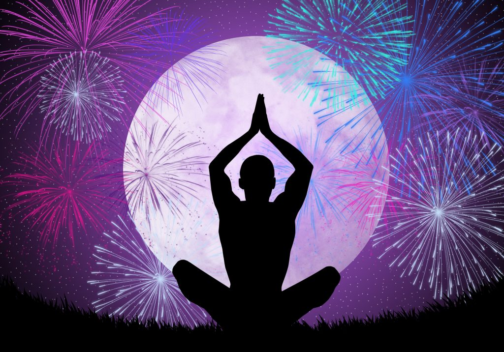 Yoga meditation in the night with fireworks