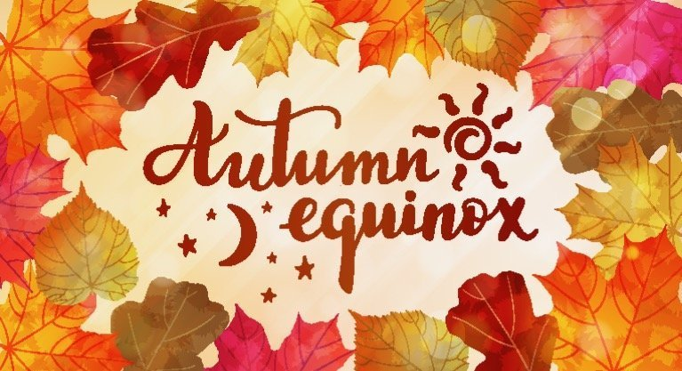 The words Autumn Equinox with a hand drawn sun and moon in the center. Surrounded by fall leaves.