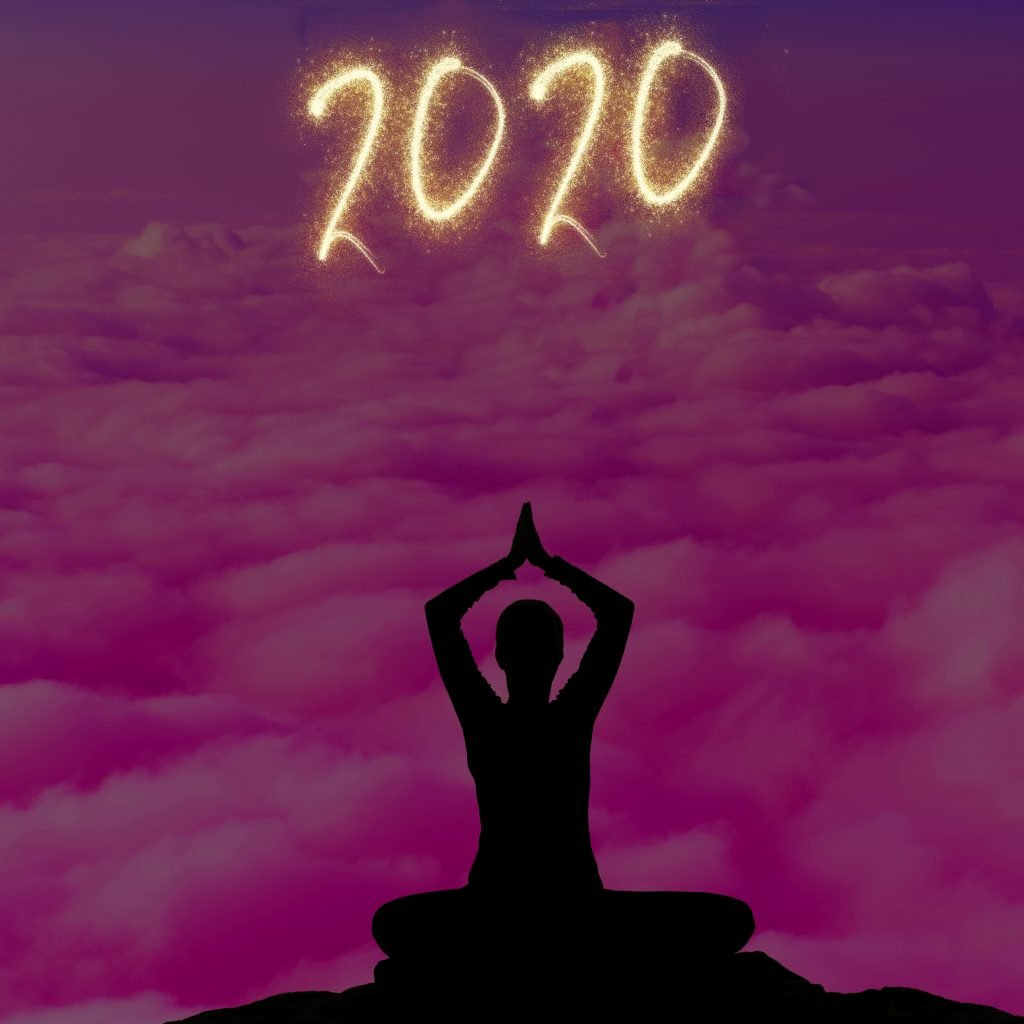 Outline of yogi in lotus with a sparkly 2020 overhead. The background is in purple background of clouds.